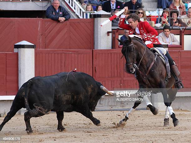 Spanish Rejoneo bullfighter on horseback Pablo Hermoso de Mendoza performs a pass on a bull during the San Isidro Feria at Las Ventas bullring in...