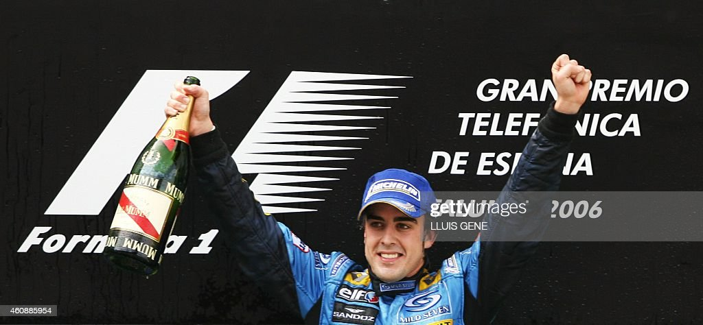 Spanish Renault driver Fernando Alonso celebrates on the podium after winning the Formula one Spanish Grand Prix 14 May 2006 at the Catalunya...