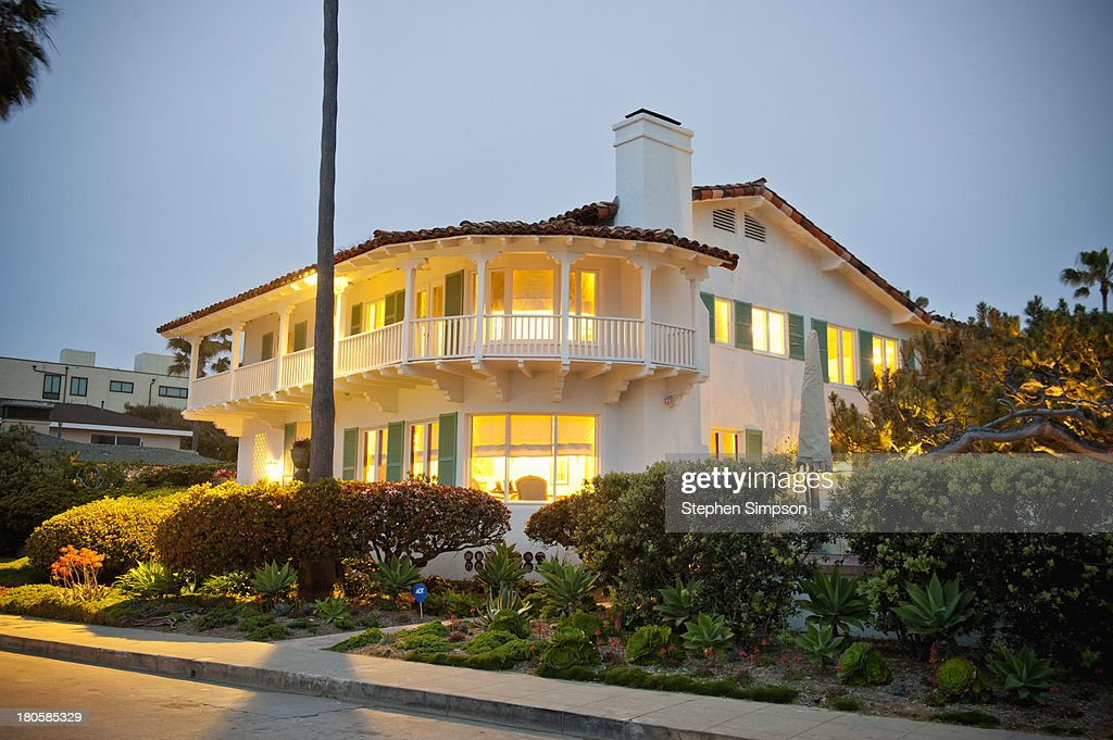 Spanish revival home, evening with interior lights : Stock Photo