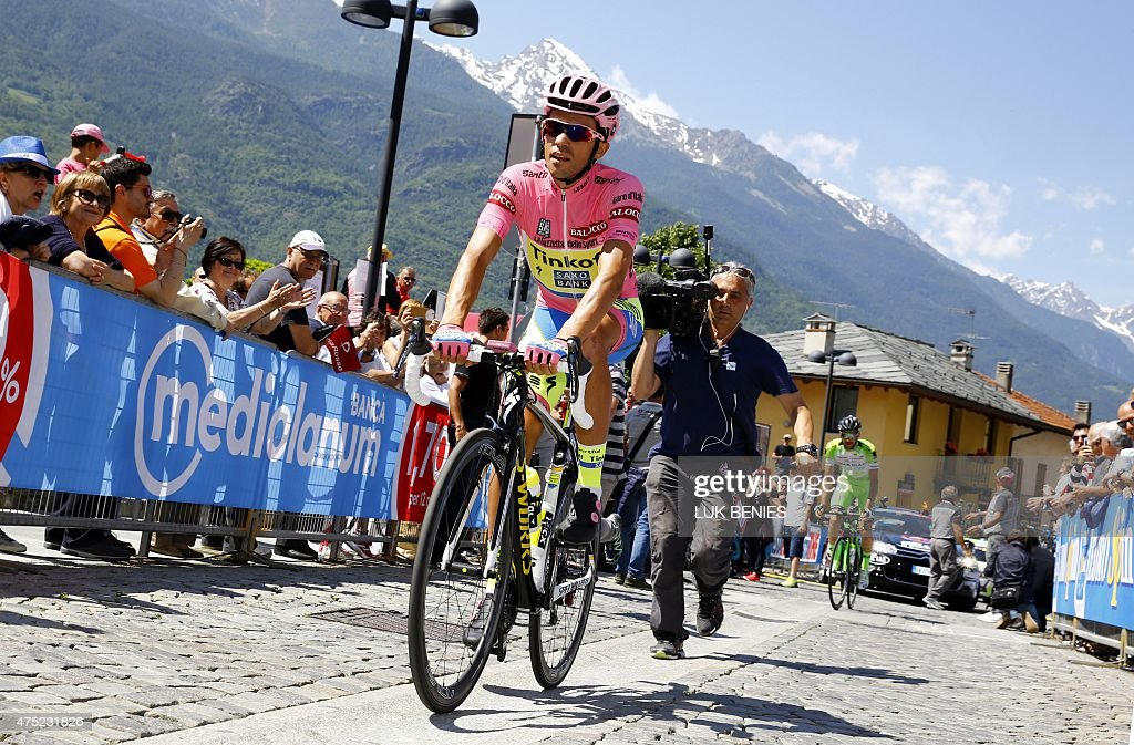 Spanish rider and bearer of the Pink Jersey Alberto Contador prepares for the start of the 20th stage of the 98th Giro d'Italia Tour of Italy cycling...