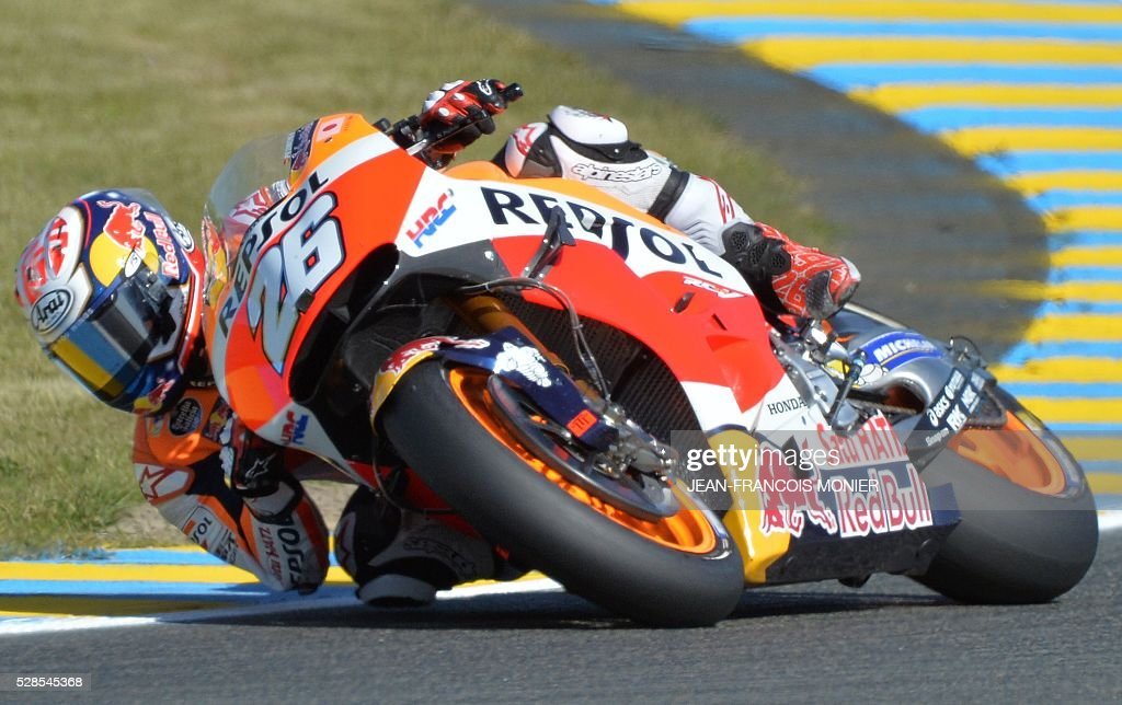 Spanish rider Dani Pedrosa competes on his Repsol Honda Team's N��26 during a motoGP free practice session, ahead of the French motorcycling Grand Prix, on May 6, 2016 in Le Mans, northwestern France. / AFP / JEAN