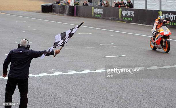 Spanish rider Dani Pedrosa crosses the finish line and won the French Moto GP Grand Prix at Le Mans' circuit western France on May 19 2013 AFP PHOTO...