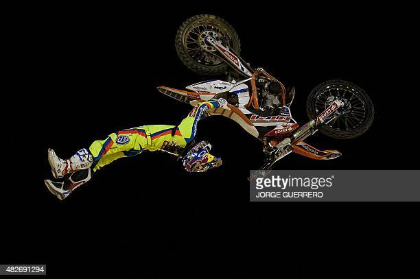 Spanish rider Dani Torres jumps during the Malaga Freestyle Motocross show on August 1 2015 AFP PHOTO/ JORGE GUERRERO