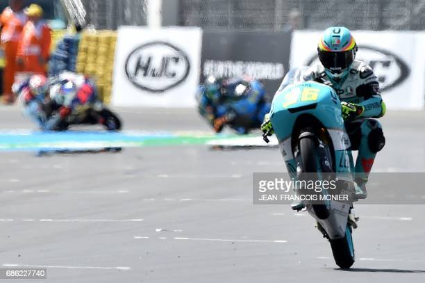 Spanish rider Joan Mir crosses the finish line on his Leopard racing N°36 during a moto3 race warmup practice session of the French motorcycling...