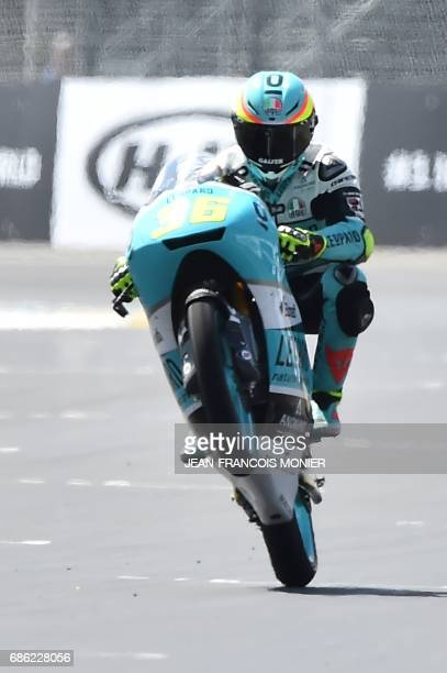 Spanish rider Joan Mir crosses the finish line on his Leopard racing N°36 to win a moto3 race warmup practice session of the French motorcycling...