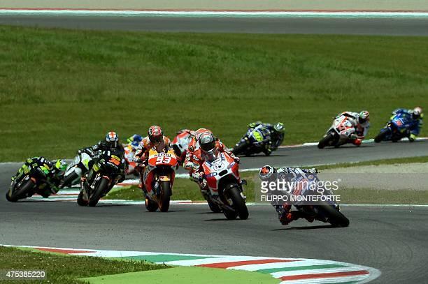 Spanish rider Jorge Lorenzo of Yamaha leads the pack at the start of the Italian Grand Prix at the Mugello racetrack on May 31 2015 Lorenzo won the...