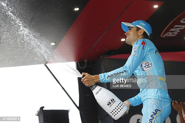 Spanish rider Mikel Landa celebrates on the podium after winning the 15th stage of the 98th Giro d'Italia Tour of Italy cycling race between...