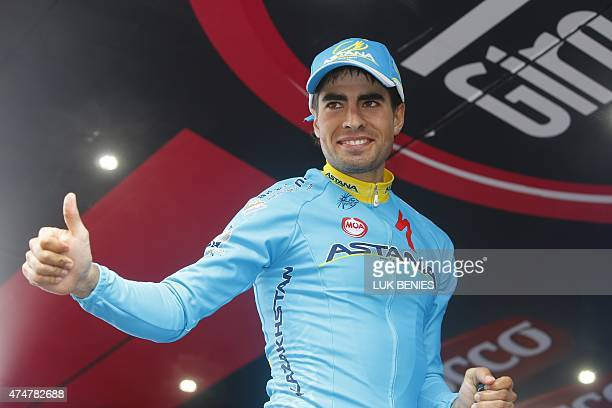 Spanish rider Mikel Landa celebrates on the podium after winning the 16th stage of the 98th Giro d'Italia Tour of Italy cycling race between Pinzolo...