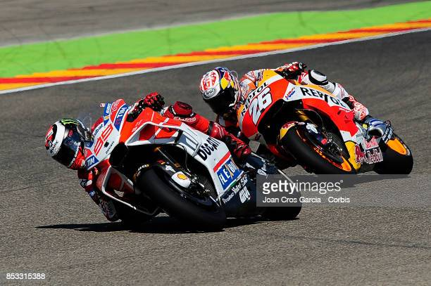 Spanish riders Jorge Lorenzo of Ducati Team and Daniel Pedrosa of Repsol Honda Team fighting for the 2nd place during the Gran Premio Movistar de...