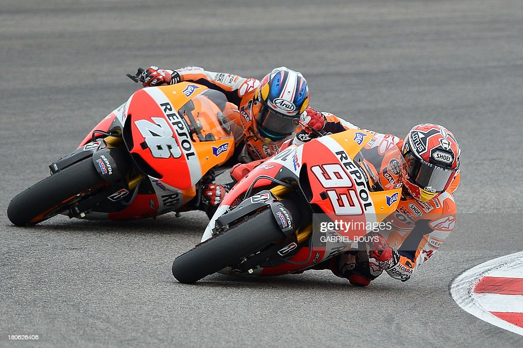 Spanish riders Marc Marquez (R) and Dani Pedrosa steer their Honda during the San Marino MotoGP Grand Prix on September 15, 2013 at the Misano world circuit in Misano Adriatico. Yamaha rider Jorge Lorenzo of Spain won the race ahead of Spanish Honda riders Marc Marquez, second place and Dani Pedrosa, third.