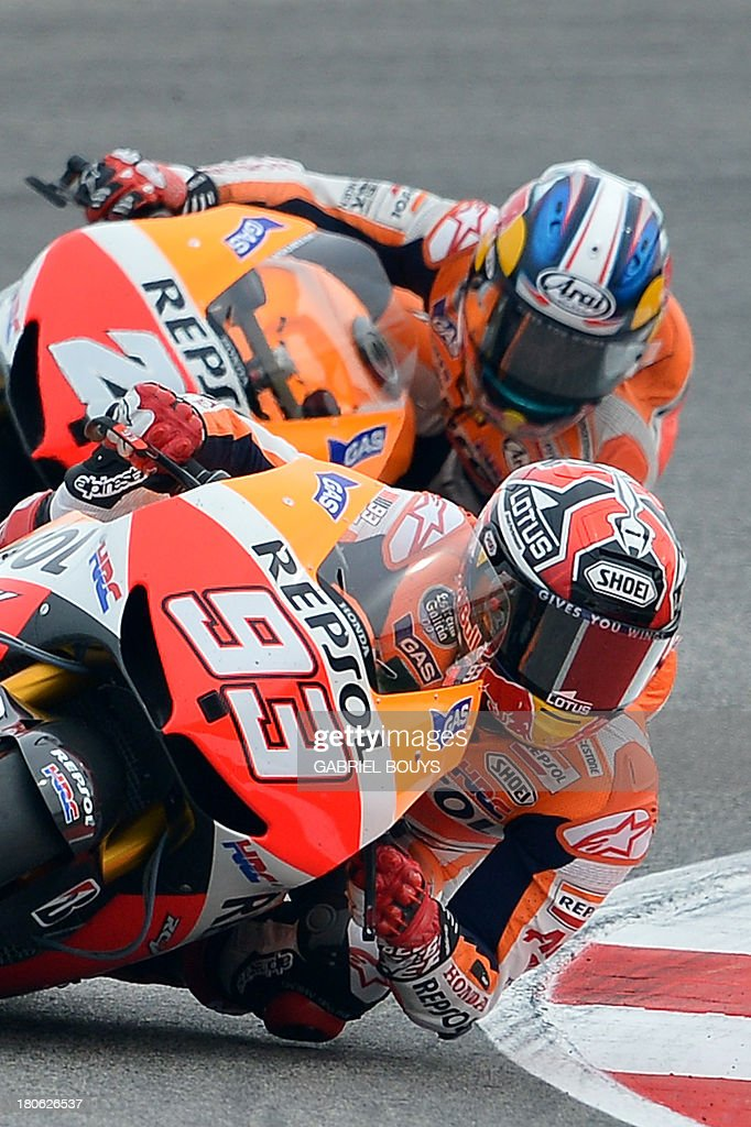 Spanish riders Marc Marquez (#93) and Dani Pedrosa steer their Honda during the San Marino MotoGP Grand Prix on September 15, 2013 at the Misano world circuit in Misano Adriatico. Yamaha rider Jorge Lorenzo of Spain won the race ahead of Spanish Honda riders Marc Marquez, second place and Dani Pedrosa, third.
