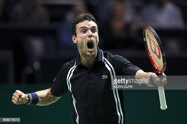 Spanish Roberto Bautista Agut celebrates after winning against Czech Republic's Jiri Vesely during their second round match of the ABN AMRO World...