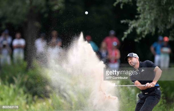Spanish Sergio Garcia plays the ball from the bunker during his match at the first final day of the BMW International Open golf tournament in...