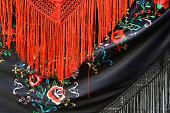 Red & black shawls on sale in Cordoba