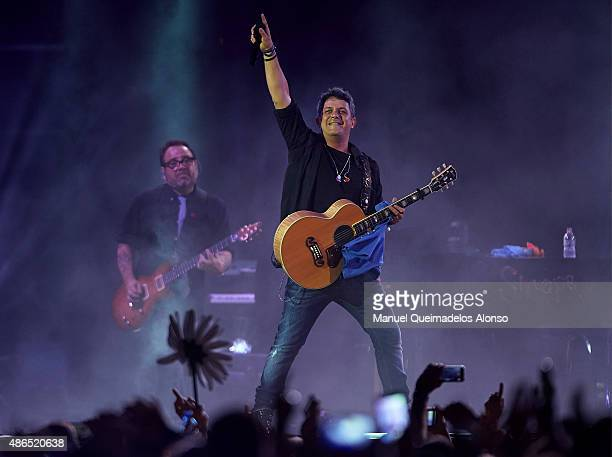 Spanish singer Alejandro Sanz performs on stage during his Sirope Tour at Valencia bullring on September 4 2015 in Valencia Spain