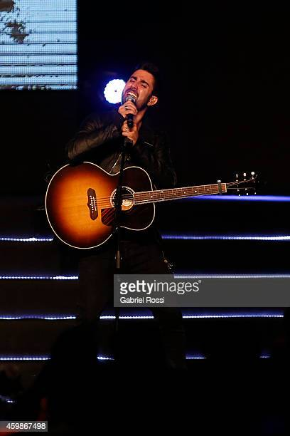 Spanish singer Alex Ubago performs during the Official Draw of the 56th Copa Bridgestone Libertadores at Conmebol Convention Center on December 2...