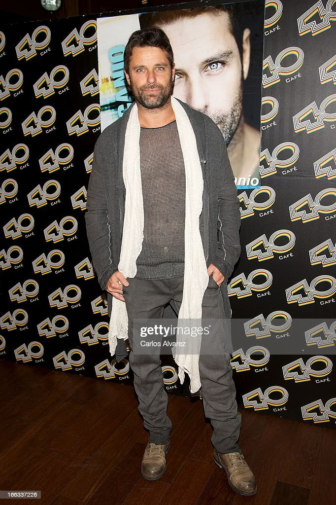 Spanish singer David Ascanio poses for the photographers before his concert at the Cafe 40 Club on April 11, 2013 in Madrid, Spain.