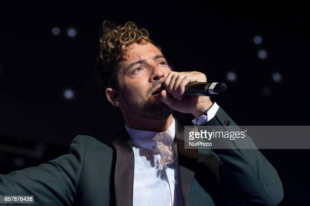 Spanish singer David Bisbal performs on stage during the 'La noche de Cadena 100' concert held at the Sports Palace in Madrid Spain 25 March 2017