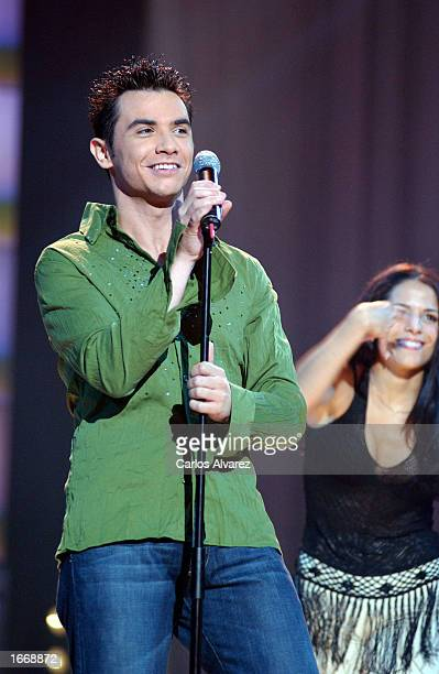Spanish singer David Civera performs on stage at the 'UPA Show A3 Television' gala December 2 2002 in Madrid Spain