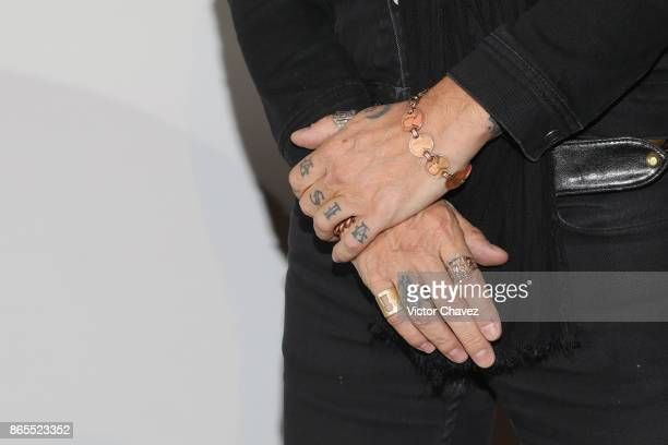 Spanish singer Enrique Bunbury tattoo and jewelry detail attends a press conference to promote his new album 'Expectativas' at at Cinema Coyoacan on...
