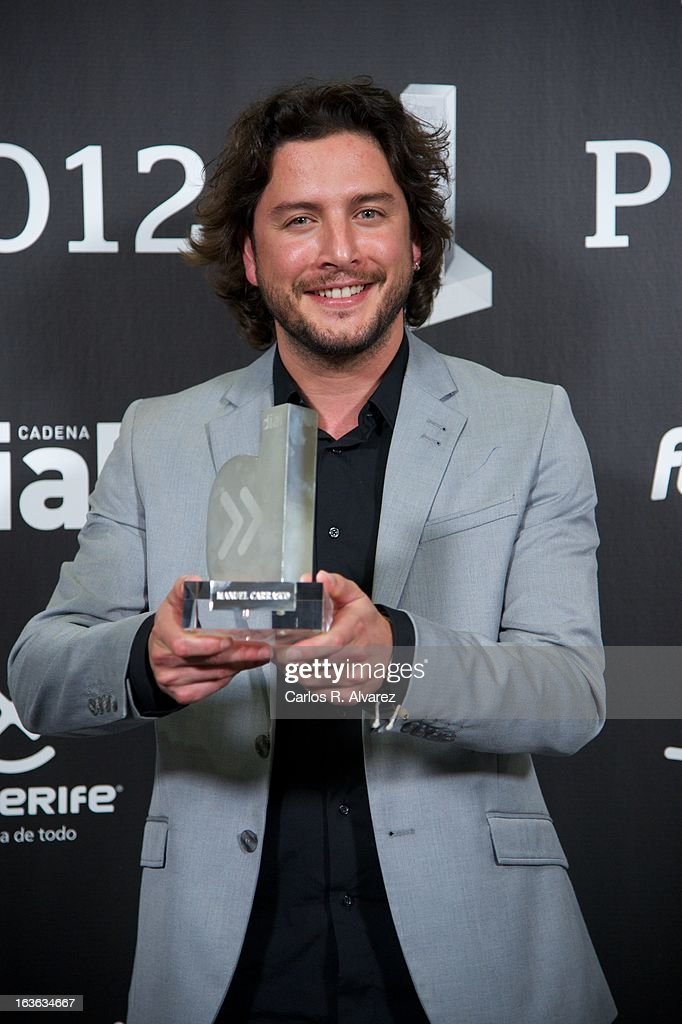 Spanish singer Manuel Carrasco holds his 'Cadena Dial' award during the Cadena Dial awards 2013 at the Adan Martin auditorium on March 13, 2013 in Tenerife, Spain.