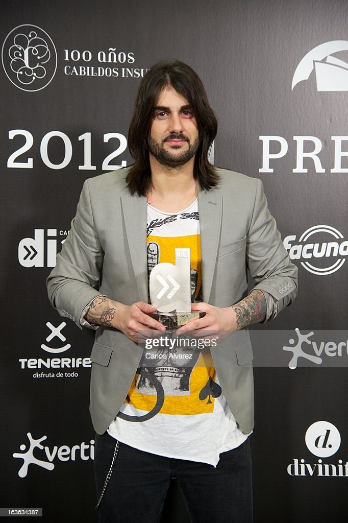 Spanish singer <a gi-track='captionPersonalityLinkClicked' href=/galleries/search?phrase=Melendi&family=editorial&specificpeople=4644180 ng-click='$event.stopPropagation()'>Melendi</a> holds his 'Cadena Dial' award during the Cadena Dial awards 2013 at the Adan Martin auditorium on March 13, 2013 in Tenerife, Spain.