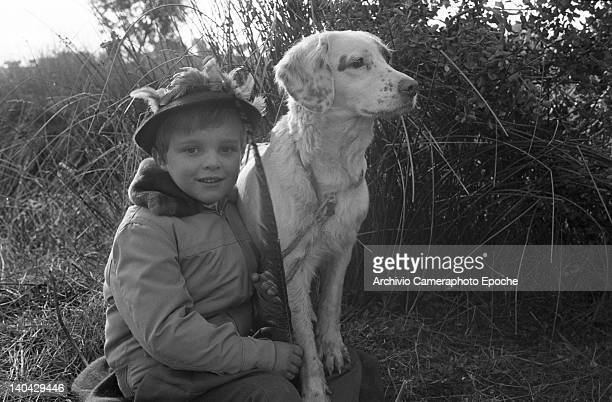 Spanish singer Miguel Bose posing with a hound dog during a hunting trip Madrid 1961