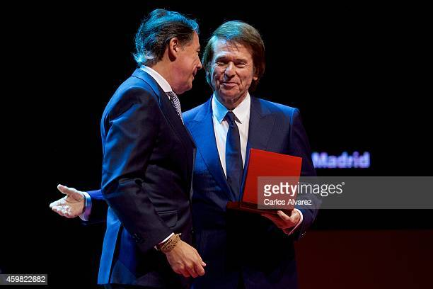 Spanish singer Raphael receives the 'International Medal of The Arts' 2013 award from Madrid Regional President Ignacio Gonzalez at the Theater Canal...
