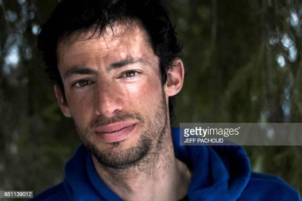 Spanish ski mountaineering and trail champion Kilian Jornet Burgada poses on March 9 2017 Areches / AFP PHOTO / JEFF PACHOUD