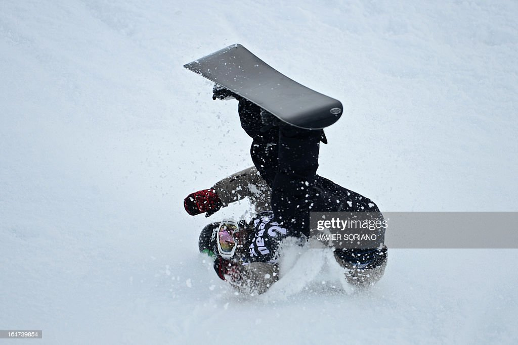 Spanish snowboarder Ruben Verges falls during the Men's Half-Pipe final race at the Snowboard and FreeStyle World Cup Super finals at Sierra Nevada ski resort near Granada on March 27, 2013.