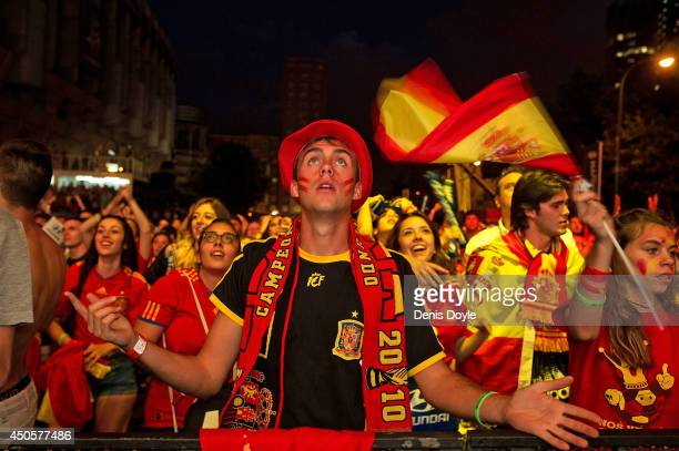 Spanish soccer fan watches as his team plays against the Netherlands on the giant screen showing the FIFA World Cup match between Spain and the...