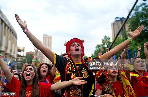 Spanish soccer fans watch as their team plays against the Netherlands on the giant screen showing the FIFA World Cup match on June 13 2014 in Madrid...