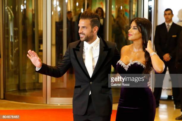 Spanish soccer player Cesc Fabregas and his wife Daniella Semaan pose for pictures on the red carpet during Lionel Messi and Antonela Rocuzzo's...