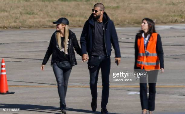 Spanish soccer player Gerard Pique and his wife Colombian singer Shakira arrive to Rosario's Islas Malvinas International Airport ahead of Lionel...