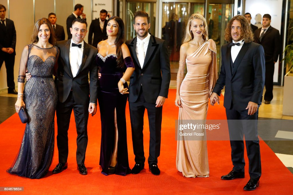 Spanish soccer player Xavi Hernández, his wife Nuria Cunillera, Spanish soccer player Cesc Fabregas and his wife Daniella Semaan, Spanish former soccer player Carles Puyol and his wife Vanesa Lorenzo pose for pictures on the red carpet during Lionel Messi and Antonela Rocuzzo's Wedding at City Center Hotel on June 30, 2017 in Rosario, Argentina.