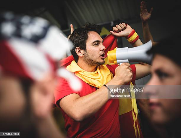 Spanish soccer supporter screaming at the edge of field