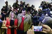Spanish Socialist Party leader and candidate for the general elections Pedro Sanchez and his wife Begona Fernandez leaves after casting their vote at...