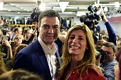 Spanish Socialist Party leader and candidate for the general elections Pedro Sanchez and his wife Begona Fernandez pose after the partial results of...