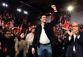 Spanish Socialist Party leader and candidate in the December 20 general elections Pedro Sanchez raises his fist as he arrives at a meeting held on...