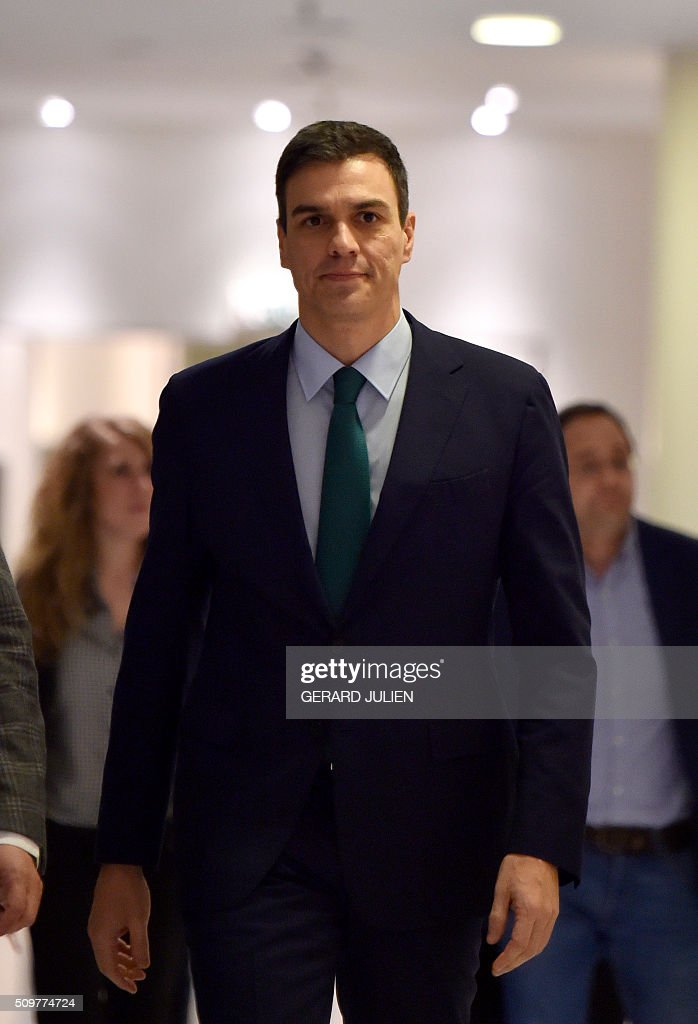 Spanish Socialist Party (PSOE) leader Pedro Sanchez arrives to give a press conference after his meeting with Spain's acting Prime Minister at the Spanish parliament in Madrid on February 12, 2016. Spain has been plunged in political uncertainty since December 20 elections put an end to the long-established two-party, conservative-socialist system with the emergence of Podemos and Ciudadanos, resulting in a parliament fractured along four main groupings that makes any government formation difficult. / AFP / GERARD JULIEN