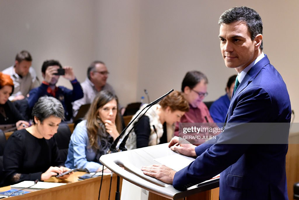 Spanish Socialist Party (PSOE) leader Pedro Sanchez (R) gives a press conference after his meeting with Spain's acting Prime Minister at the Spanish parliament in Madrid on February 12, 2016. Spain has been plunged in political uncertainty since December 20 elections put an end to the long-established two-party, conservative-socialist system with the emergence of Podemos and Ciudadanos, resulting in a parliament fractured along four main groupings that makes any government formation difficult. / AFP / GERARD JULIEN