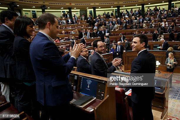 Spanish Socialist Party leader Pedro Sanchez looks on as party members applause him after his speech during a debate to form a new government at the...