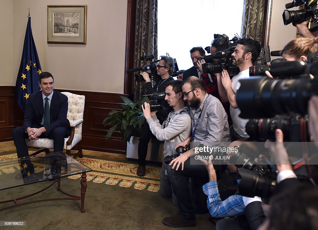 Spanish Socialist Party (PSOE) leader Pedro Sanchez (R) poses for the press before a meeting with Spain's acting Prime Minister at the Spanish parliament in Madrid on February 12, 2016. Spain has been plunged in political uncertainty since December 20 elections put an end to the long-established two-party, conservative-socialist system with the emergence of Podemos and Ciudadanos, resulting in a parliament fractured along four main groupings that makes any government formation difficult. / AFP / GERARD JULIEN