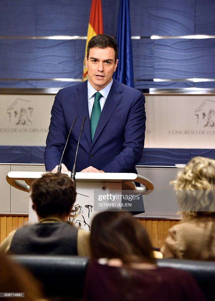 Spanish Socialist Party (PSOE) leader Pedro Sanchez (R) speaks during a press conference after his meeting with Spain's acting Prime Minister at the Spanish parliament in Madrid on February 12, 2016. Spain has been plunged in political uncertainty since December 20 elections put an end to the long-established two-party, conservative-socialist system with the emergence of Podemos and Ciudadanos, resulting in a parliament fractured along four main groupings that makes any government formation difficult. / AFP / GERARD JULIEN
