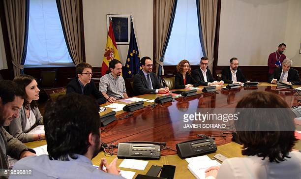 Spanish Socialist Party Podemos party and Ciudadanos Party negotiating teams sit together prior to holding a meeting at Las Cortes in Madrid on April...