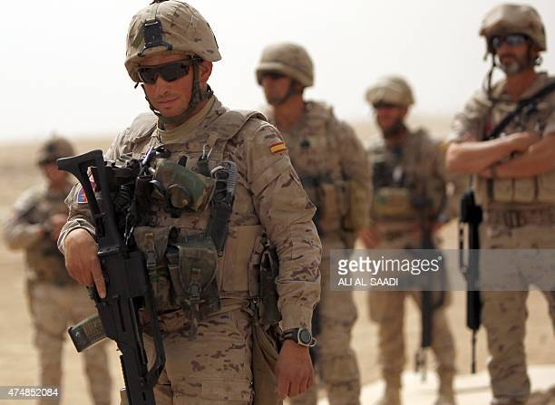A Spanish soldier looks on as thousands of Iraqi soldiers take part in a training exercise led by the Spanish Army and under the guidance of the US...