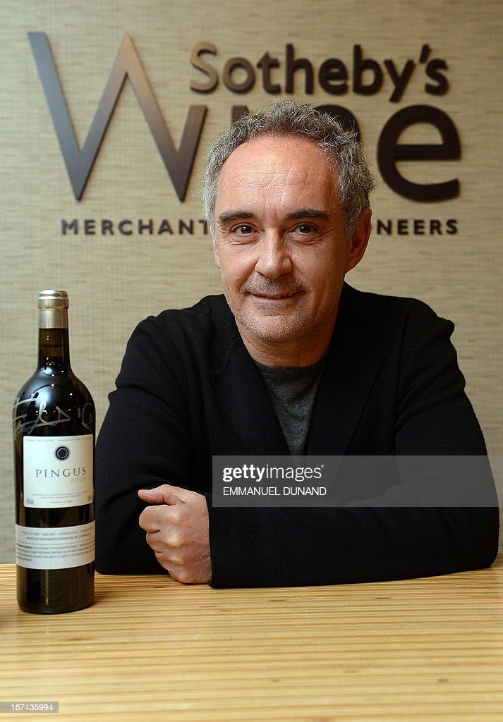 Spanish star chef Ferran Adria, of the award-winning restaurant elBulli, poses with signed wine bottles from the restaurant's wine cellar, in New York, April 25, 2013. Adria decided to permanently close his restaurant and put the entire content of elBulli's wine cellar for auction, which is scheduled for April 26, 2013 at Sotheby's. The proceeds will be used to sponsor his elBulli Foundation, aimed at preserving and celebrating the restaurant's accomplishments, while keeping it as a center for gastronomic innovation. This new endeavour would allow him and his team the freedom to continue nurturing the creative drive that had defined elBulli, but without the restrictive timetable and demands of a restaurant. AFP PHOTO/Emmanuel Dunand