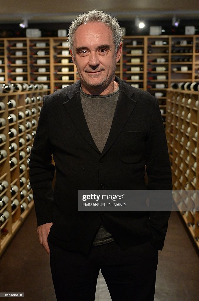 Spanish star chef Ferran Adria, of the award-winning restaurant elBulli, poses amongst wine bottles, at the wine cellar of Sotheby's Auction House, in New York, April 25, 2013. Adria decided to permanently close his restaurant and put the entire content of elBulli's wine cellar for auction, which is scheduled for April 26, 2013 at Sotheby's. The proceeds will be used to sponsor his elBulli Foundation, aimed at preserving and celebrating the restaurant's accomplishments, while keeping it as a center for gastronomic innovation. This new endeavour would allow him and his team the freedom to continue nurturing the creative drive that had defined elBulli, but without the restrictive timetable and demands of a restaurant. AFP PHOTO/Emmanuel Dunand