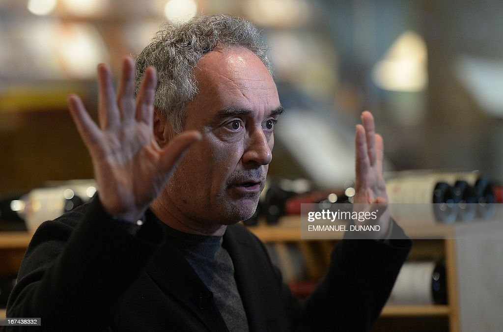 Spanish star chef Ferran Adria, of the award-winning restaurant elBulli, speaks during an interview in the wine cellar of Sotheby's Auction House, in New York, April 25, 2013. Adria decided to permanently close his restaurant and put the entire content of elBulli's wine cellar for auction, which is scheduled for April 26, 2013 at Sotheby's. The proceeds will be used to sponsor his elBulli Foundation, aimed at preserving and celebrating the restaurant's accomplishments, while keeping it as a center for gastronomic innovation. This new endeavour would allow him and his team the freedom to continue nurturing the creative drive that had defined elBulli, but without the restrictive timetable and demands of a restaurant. AFP PHOTO/Emmanuel Dunand
