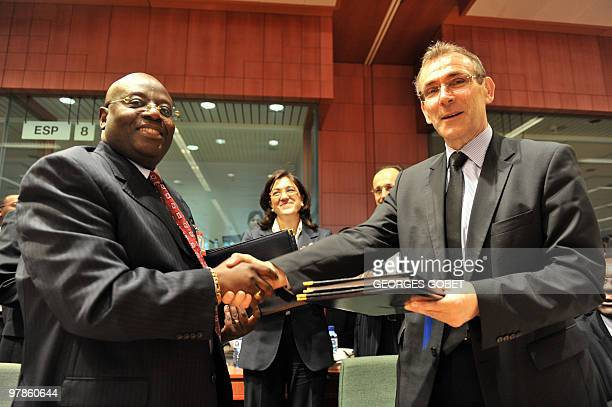 Spanish State Secretary for Cooperation Soraya Rodriguez Ramos watches as Gabonese MinisterDelegate Paul BundukuLatha and EU commissioner for...